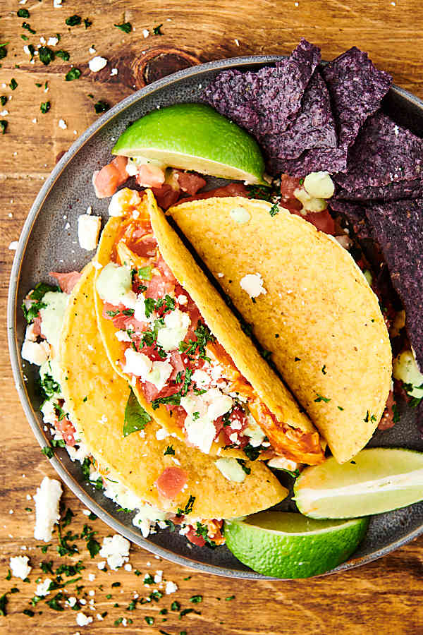 plate of instant pot salsa chicken tacos above