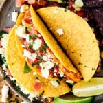 instant pot salsa chicken tacos on plate above