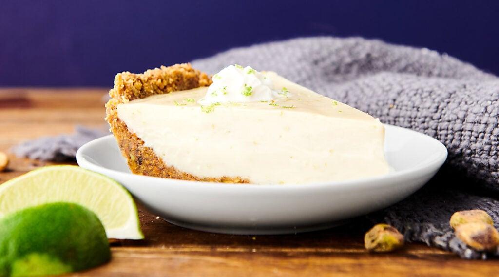 slice of key lime pie on plate
