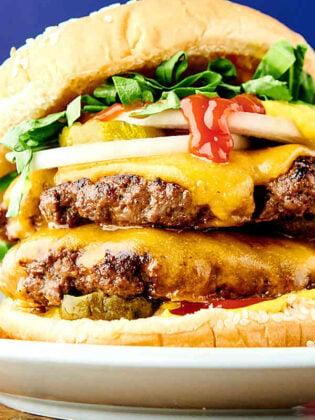 closeup of smash burger on plate