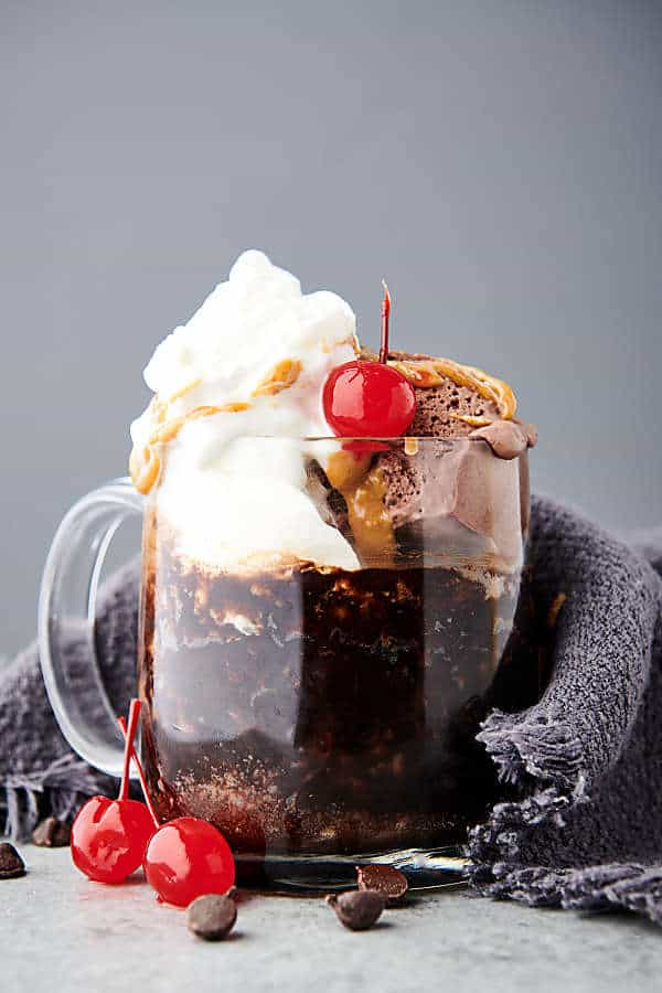 vegan mug cake topped with whipped cream side view