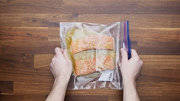 salmon and marinade in bag