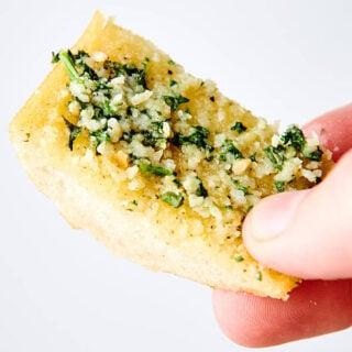 piece of garlic bread held