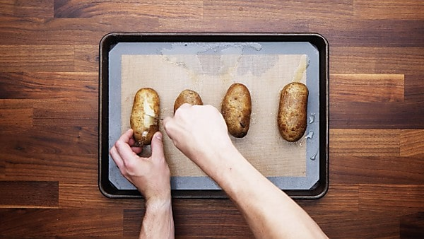 baked potato being sliced