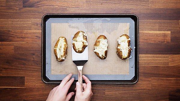 finished baked potatoes on baking sheet