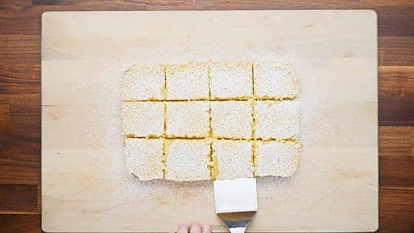 cut lemon bars topped with powdered sugar