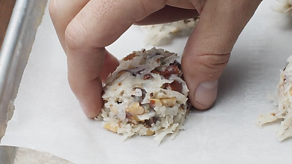 almond joy cookie being formed on baking sheet