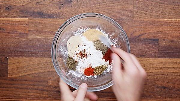 cajun seasonings in mixing bowl