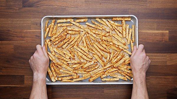 potato slices on baking sheet