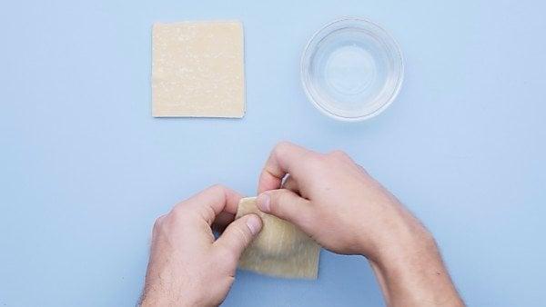 piece of cheese ravioli being sealed