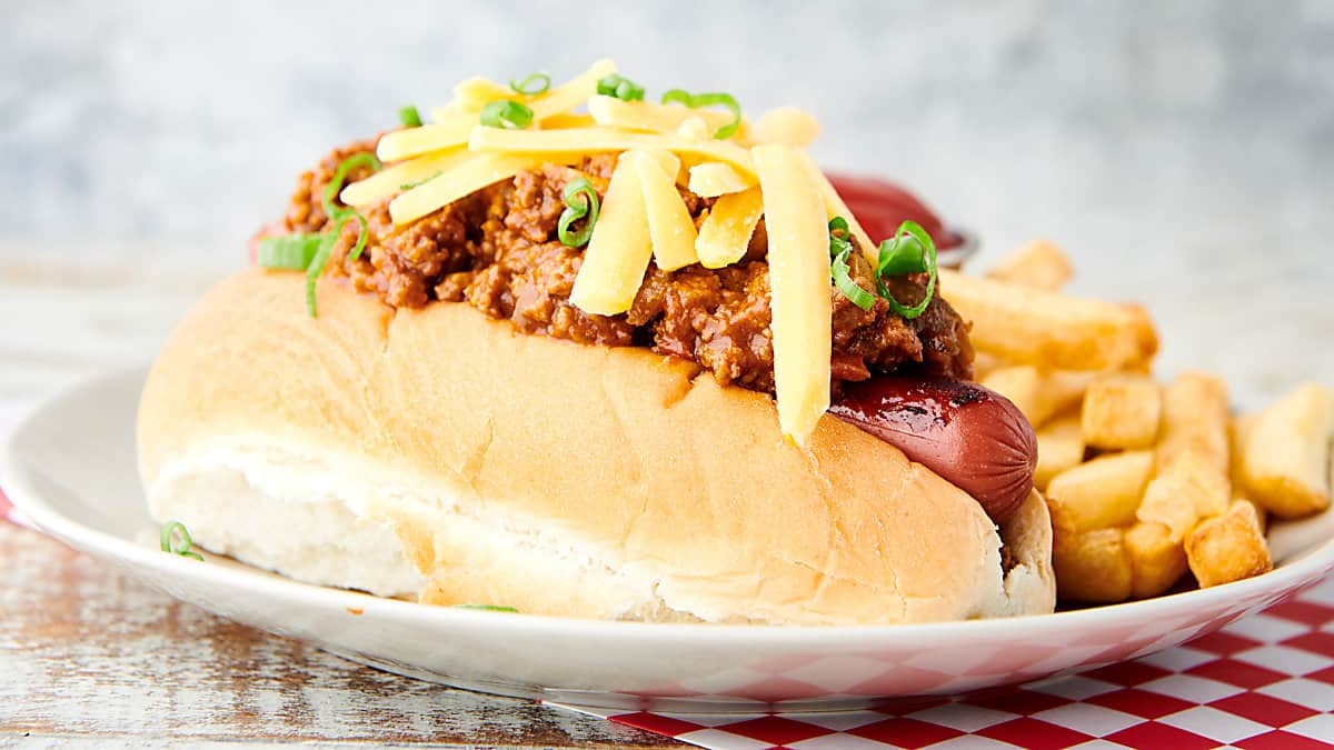 hot dog topped with hot dog chili side view