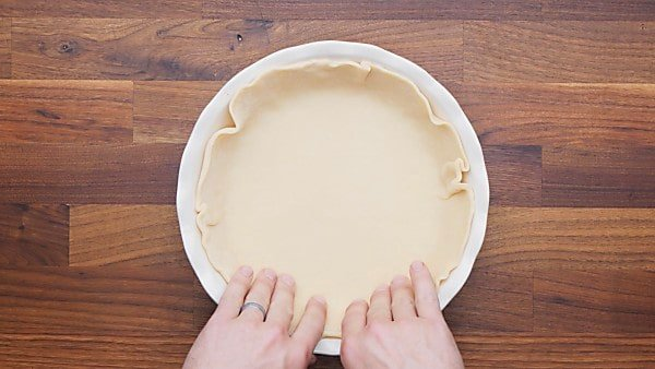 pie crust added to pie dish