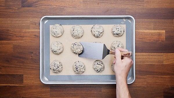 finished oreo cheesecake cookies on baking sheet