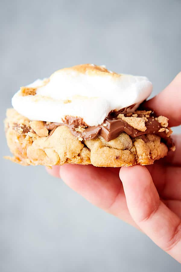 holding smore cookie in hand