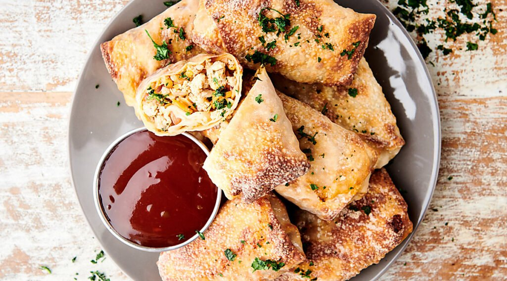 air fried egg rolls on plate above