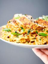 plate of cajun chicken alfredo held