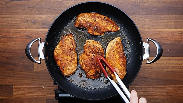 chicken breasts browned in skillet