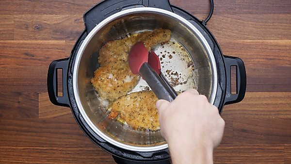 chicken being browned in instant pot