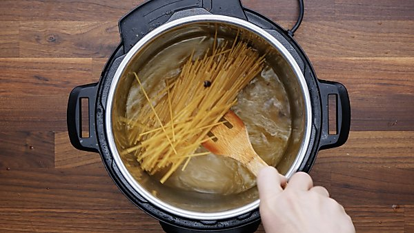 spaghetti noodles added to broth