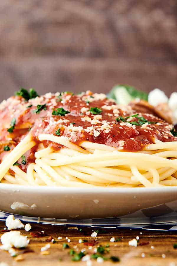 instant pot spaghetti sauce over pasta side view