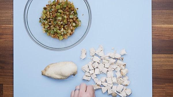 cut chicken on cutting board