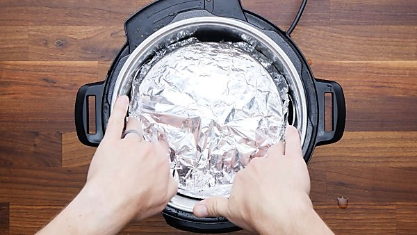 cake pan in instant pot covered with foil