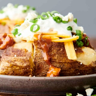 loaded air fryer baked potato on a plate