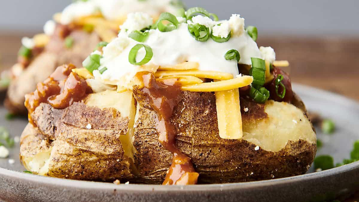 horizontal air fryer baked potato on a plate
