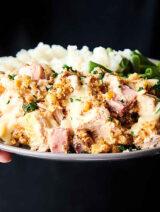 plate of crockpot chicken cordon bleu held